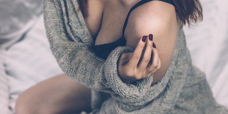 Woman in Low Cut Sweater