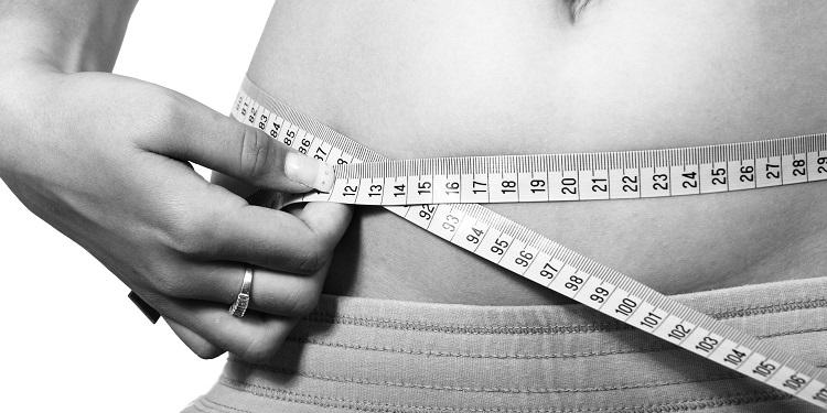 Woman Measuring Stomach