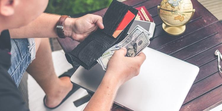 Man opening his wallet